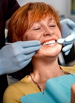 Patient and dentist examining smile in mirror
