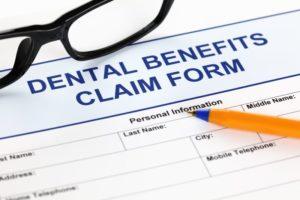 Orange pen on a dental benefits claim form