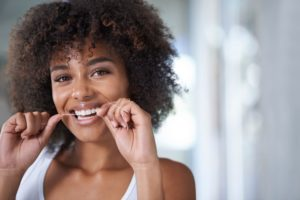new-years-resolution-flossing-more-often-dentist-in-norwood